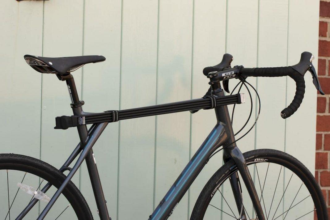 WrapStraps halten das Litelok Silver Fahrradschloss am Rahmen